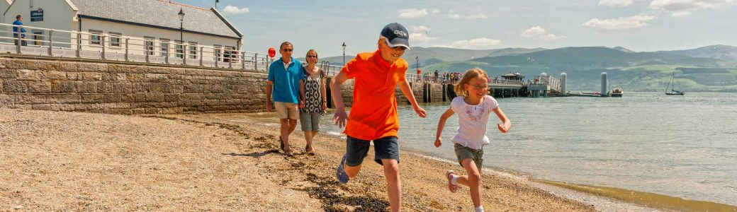 Family fun near Beaumaris Pier, Anglesey
